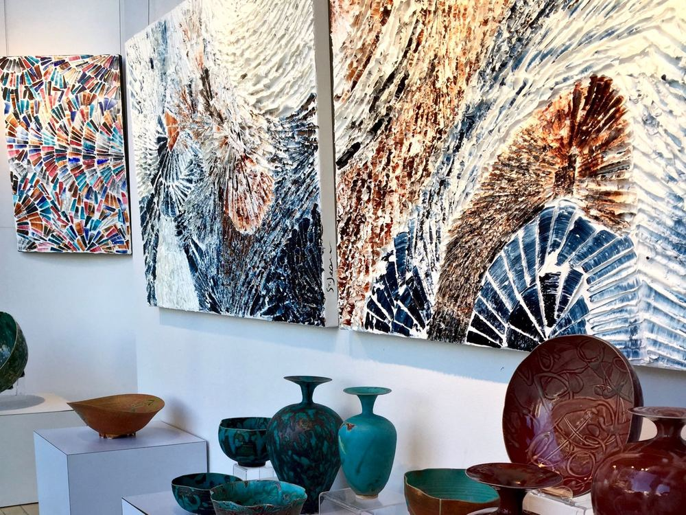 Close up view of artworks displayed on Petroff Gallery's front window