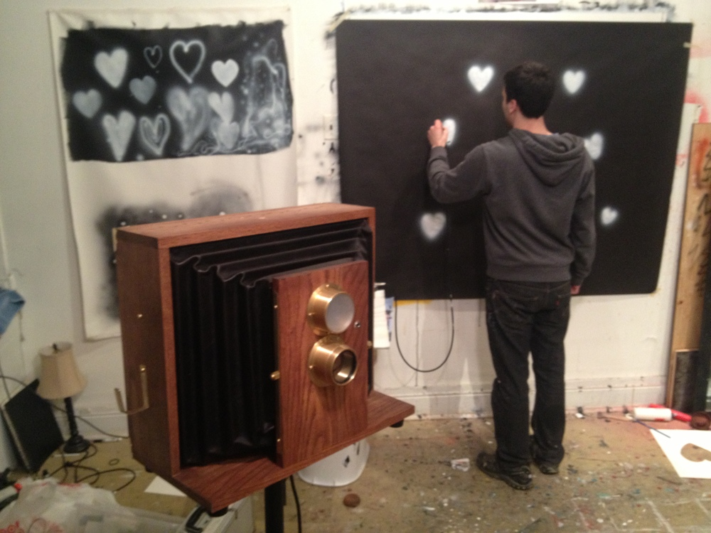 Zak Harvey our creative director helping us make the heart background!