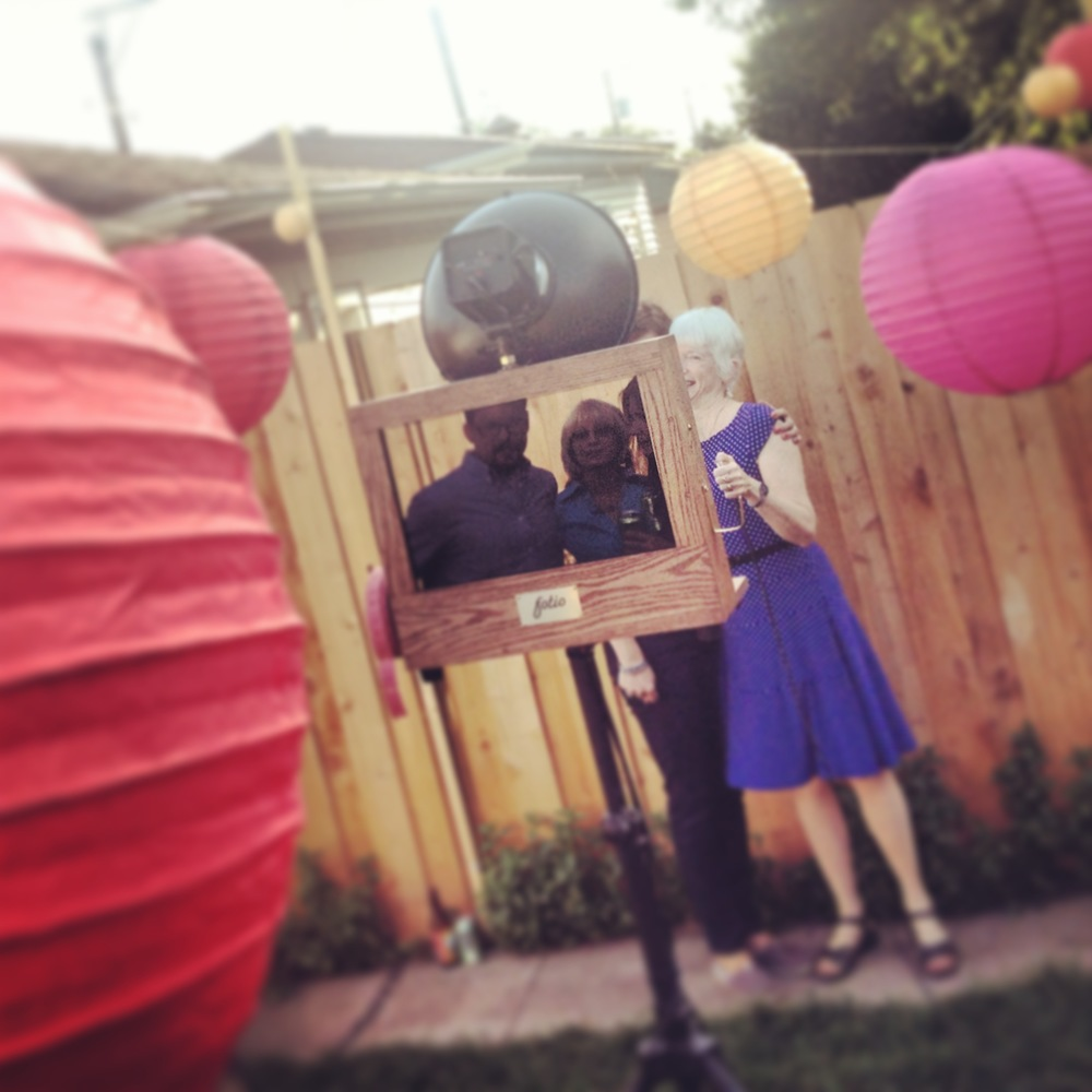 Fotio photo booth setup at a backyard BBQ graduation party in Portage Park.