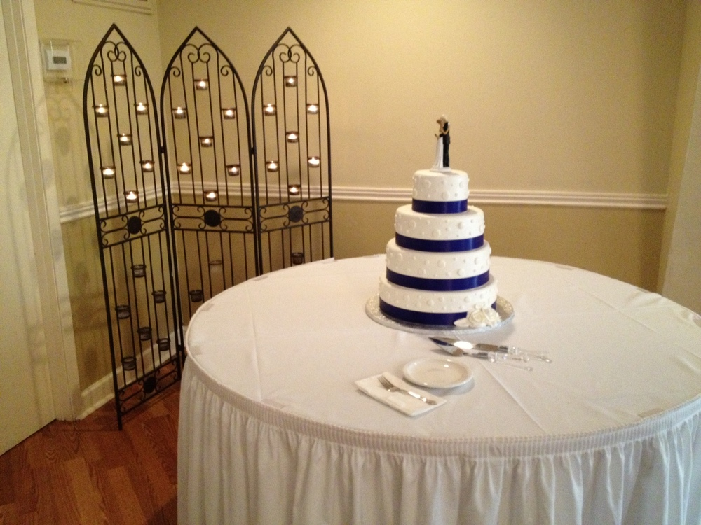 Blue striped wedding cake.
