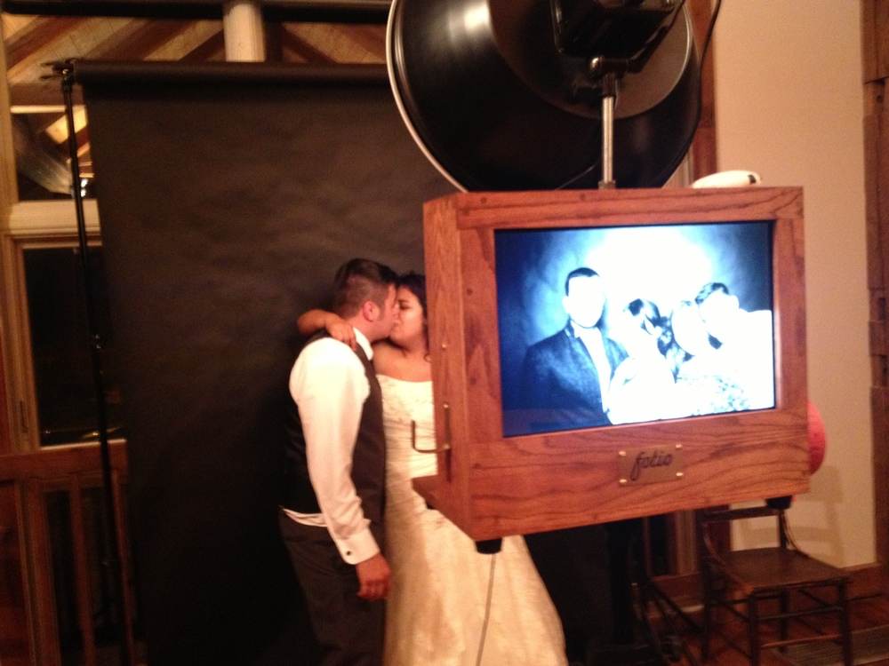 The bride and groom taking a picture!