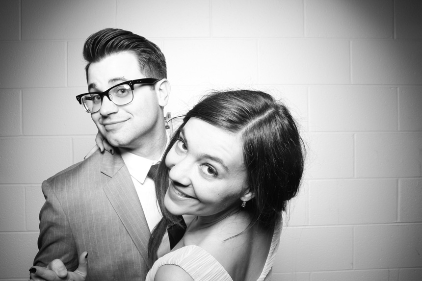 A couple poses for a Fotio photo booth portrait at Venue One.