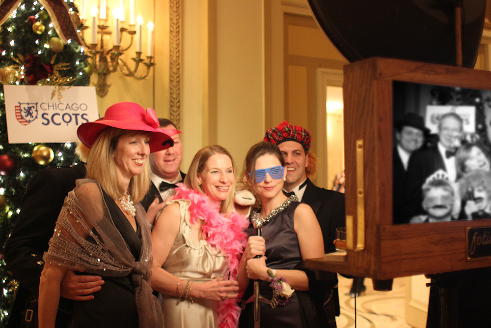 Guests pose for a photo booth picture at the Palmer House!