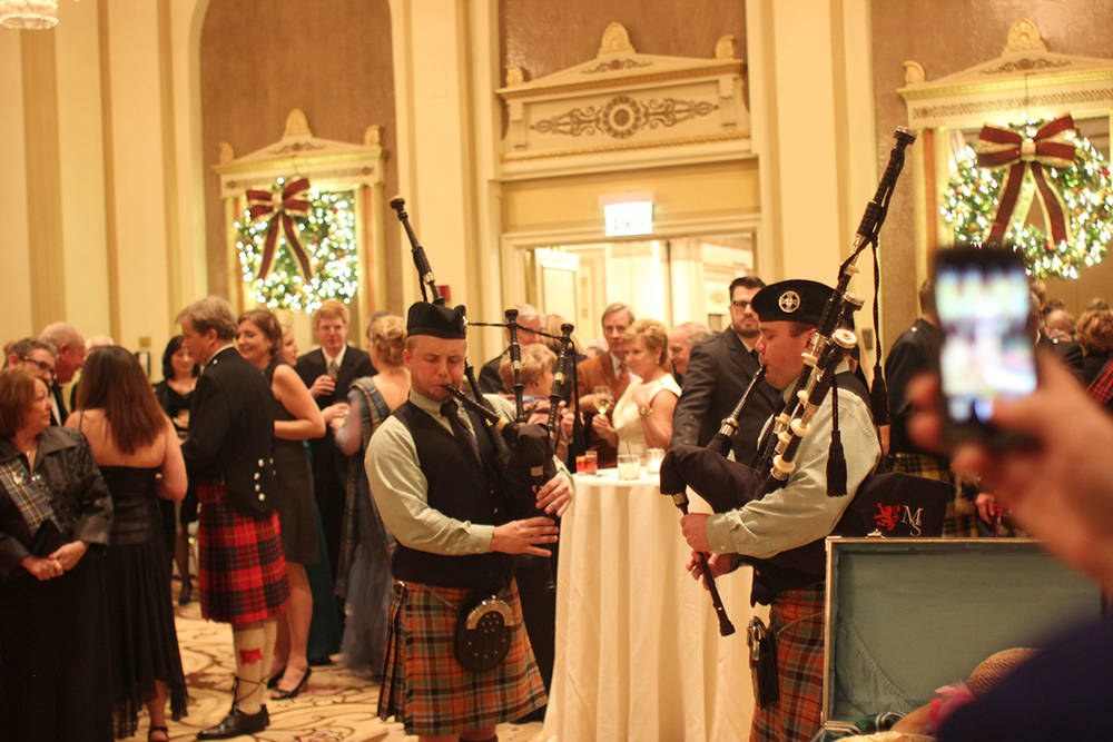 A bagpipe band plays in the foyer space for the cocktail hour at the Palmer House.