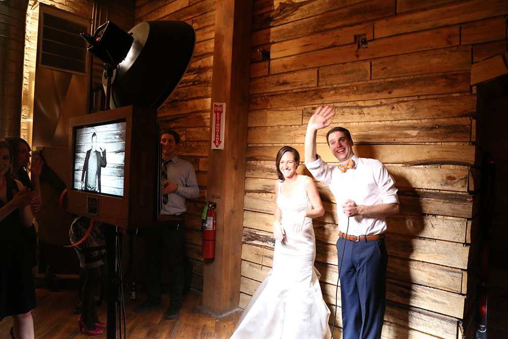 The bride and groom pose for some photo booth pictures in Lacuna's Reverie Gallery!