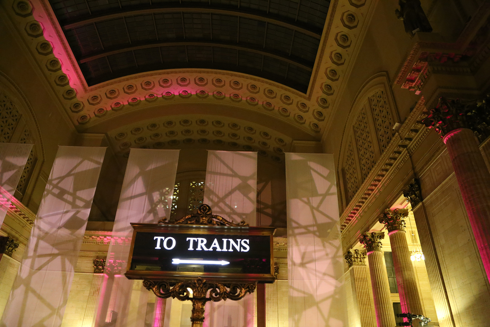 We love the cool train sign in the middle of the space paired with the amazing lighting by Frost!
