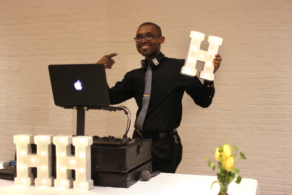 Chicago DJ Brent Rolland of Fig Media Incorporated poses for a picture with HHH letters!