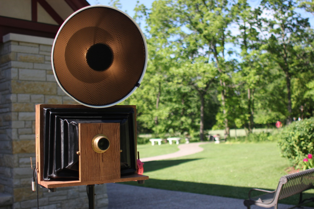 Close up picture of our vintage style open air photo booth at the Grove Redfield Estate.