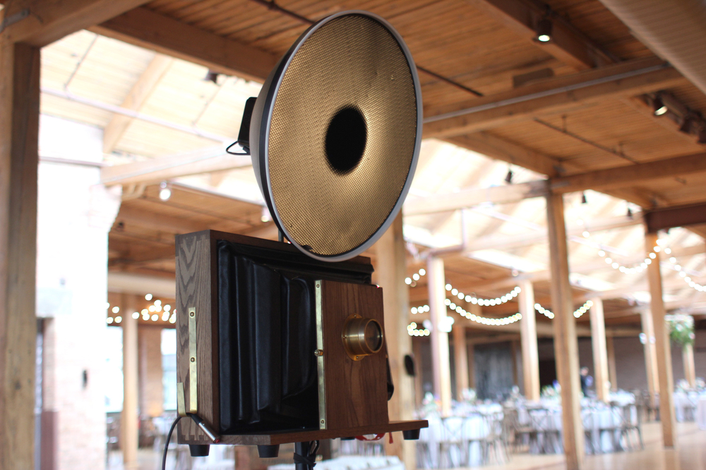 Open-air photo booth setup in the Skyline Loft at Bridgeport Art Center Wedding.