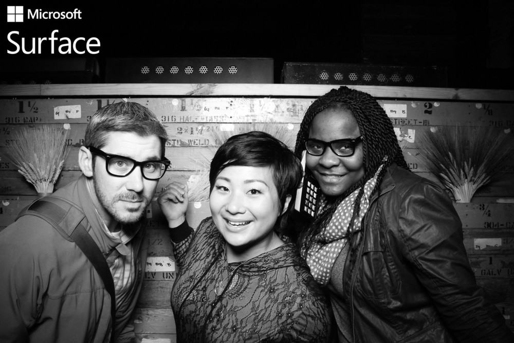 Guests pose for a photo booth picture at the Microsoft Surface party event at HQ Beercade.