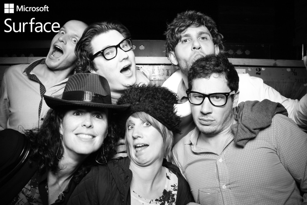 Guests loving the Fotio photo booth props at HQ Beercade River North!