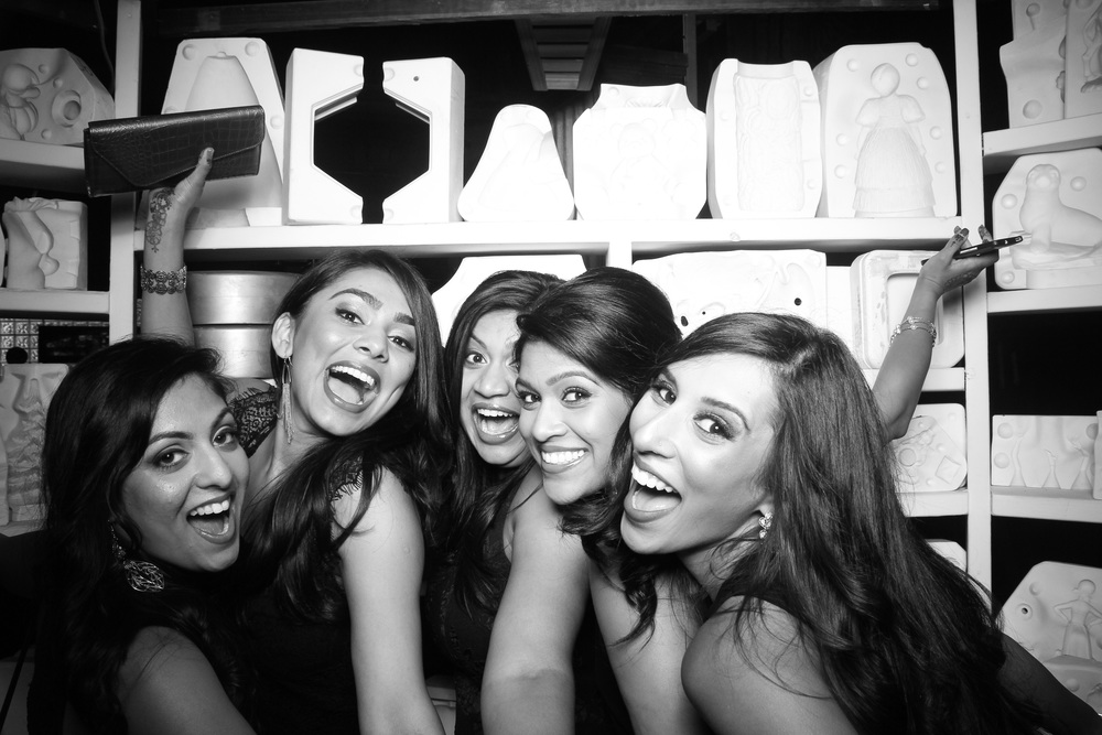 The bridesmaids having fun in the photo booth at Salvage One!