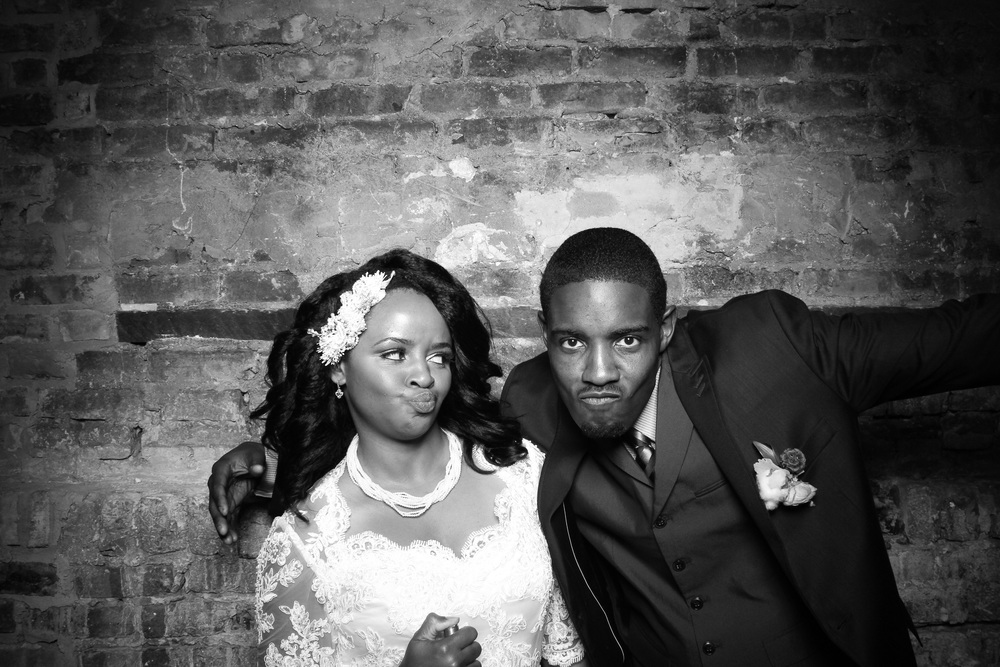 The bride and groom pose for a fun Fotio booth picture at A New Leaf Chicago!