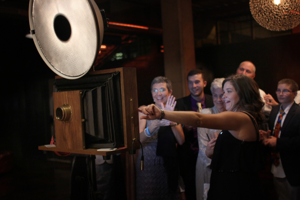 Wedding guests having fun with the photo booth at Morgan Manufacturing!