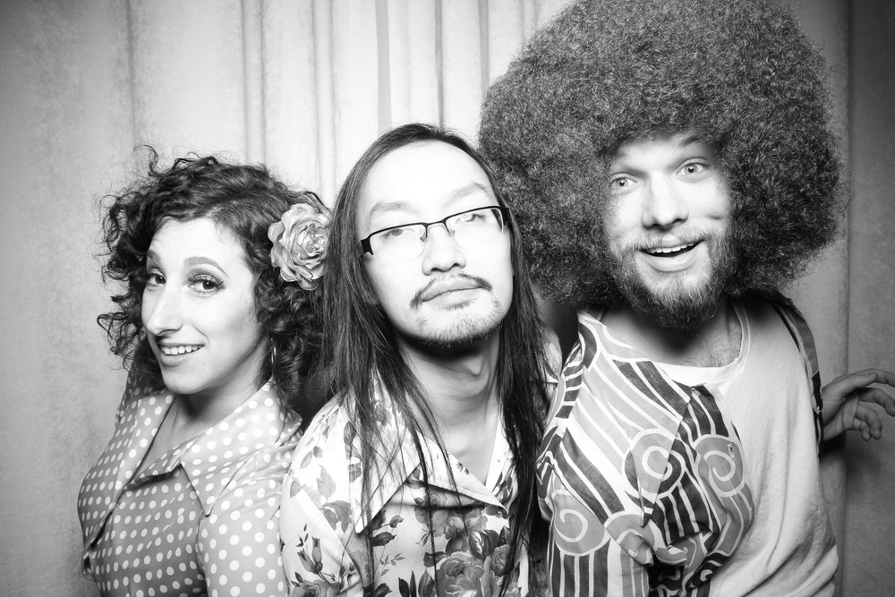 Tuan B and Co posing for a photo booth picture at Moonlight Studios.