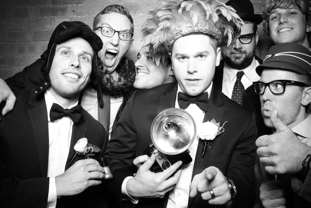 The groom gets a photo booth pic with friends at City Winery Chicago!
