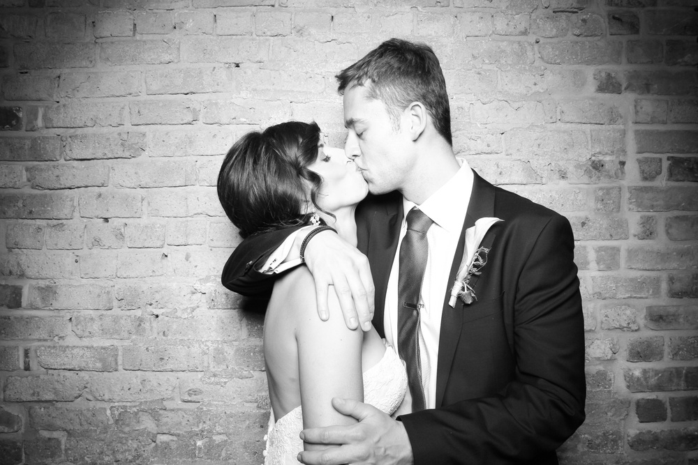 So in love! The bride and groom take a picture with Fotio photo booth at City Winery.