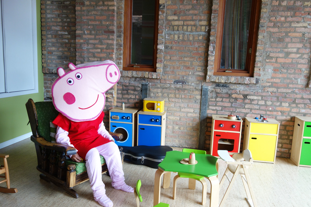Peppa lounging in the kid kitchen waiting for the little kids to arrive!