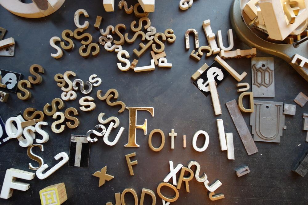 Vintage typesetting letters spell FOTIO!