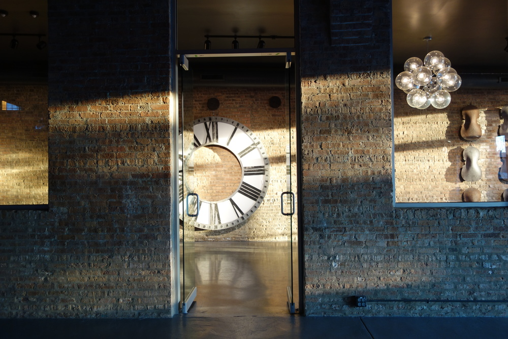 Gorgeous sunset on the giant fancy clock at Architectural Artifacts!