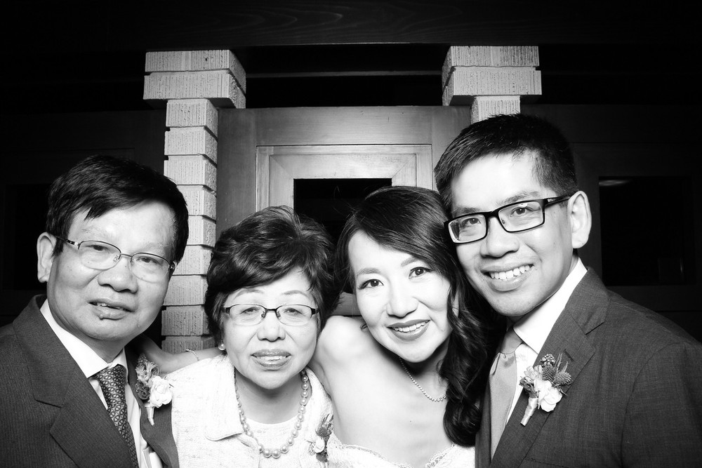 Bride and Groom pose with family at the Emil Bach House wedding!