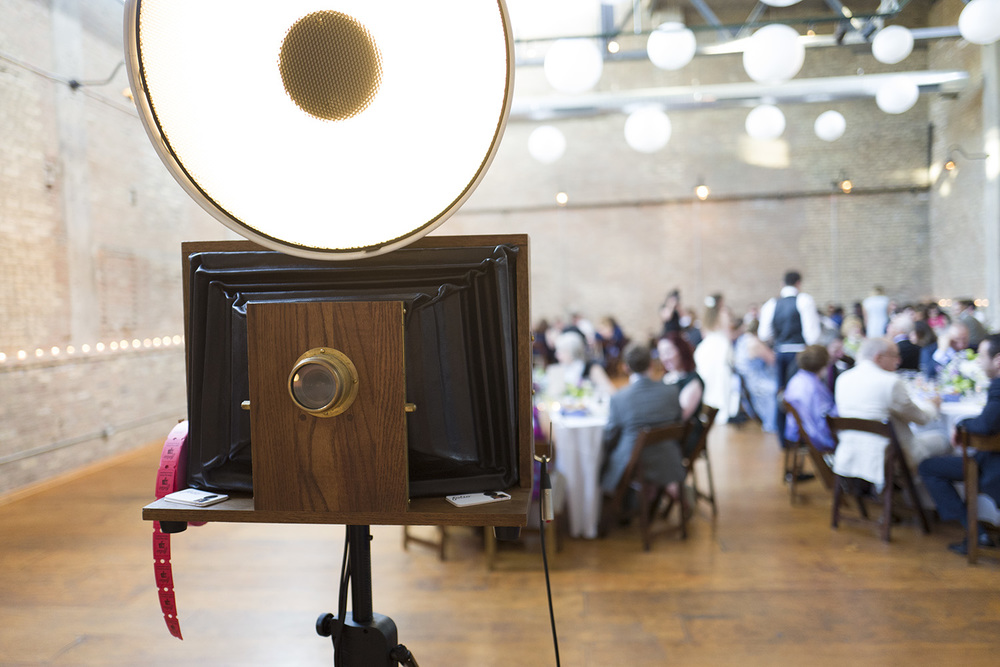 A Fotio photo booth setup in the Industrial Ballroom at Ravenswood Event Center Wedding.