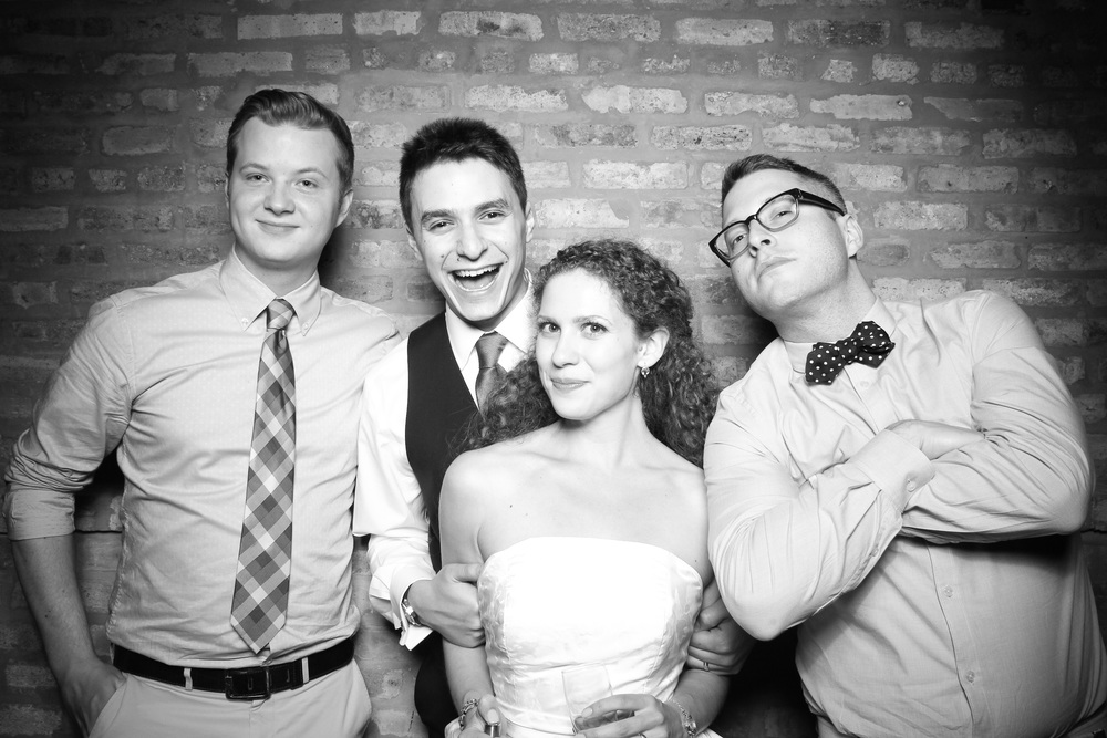 Bride and groom get a photo booth pic with friends!