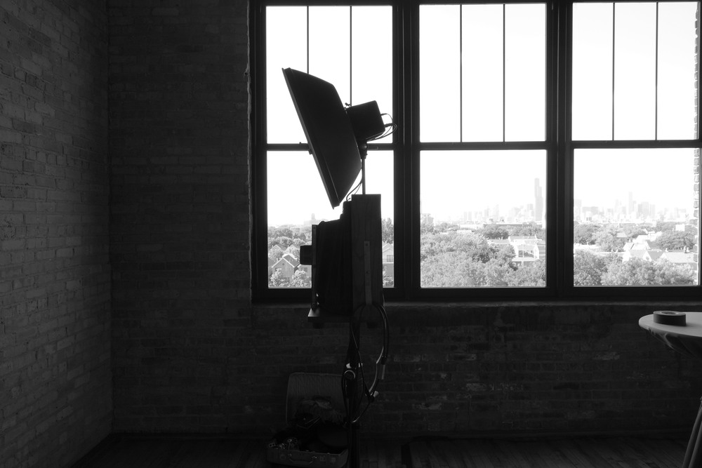 Fotio looks so cool in front of the large windows in the Skyline Loft at Bridgeport Art Center.