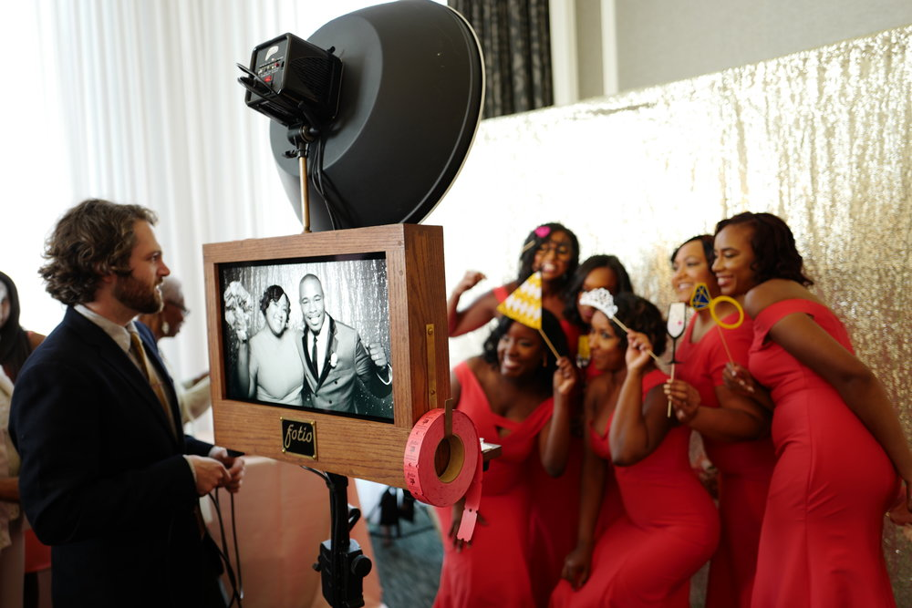 The bridesmaids pose for a photo booth picture at the Waldorf Astoria Chicago wedding!