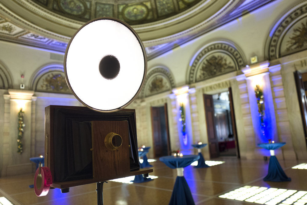 A Chicago vintage style photo booth setup outside of Gar Memorial Hall at the Chicago Cultural Center