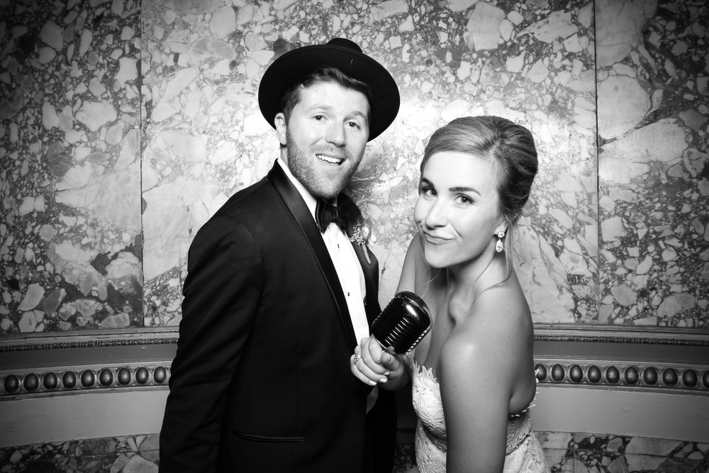 The bride and groom pose for a vintage photo booth portrait at the Congress Gold Room!