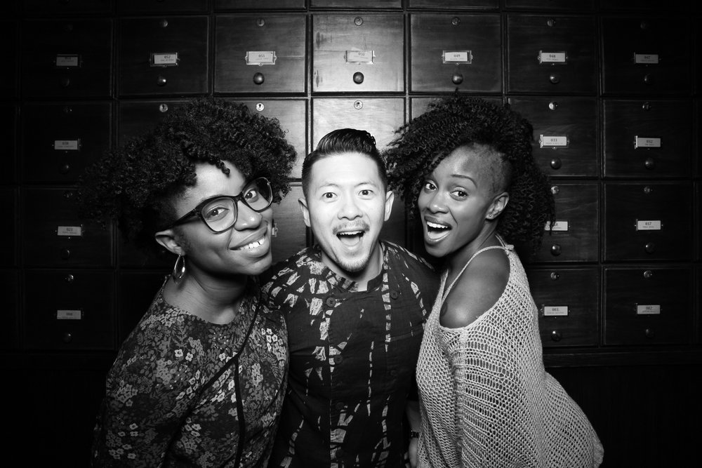 Corporate clients pose for a photo booth picture at Untitled Supper Club in the timeless Whiskey Library.