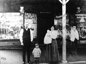 Tickner (Far Right) with the Ditherer family in front of their Barbers and Surgeons Shop in King Street, Newcastle.   Photo from the Ditherer family Achives.