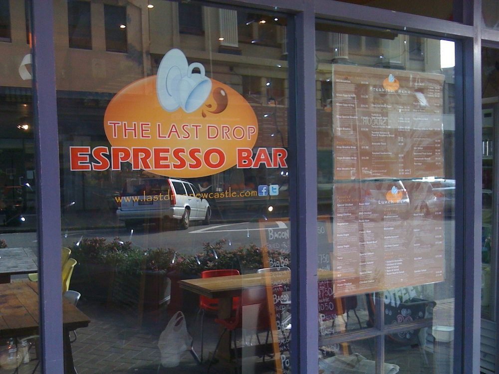 Front window of The Last Drop Espresso Bar