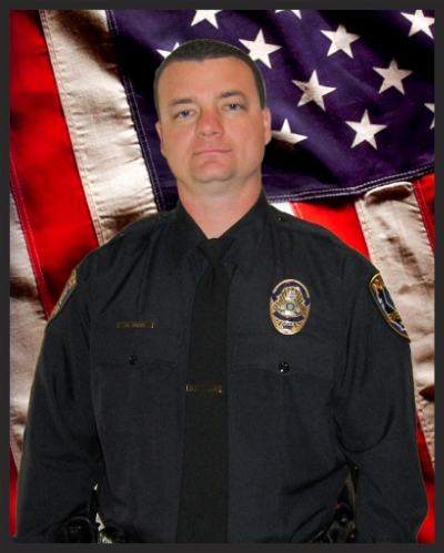 "Officer Michael ""Freight"" Crain, of Beaumont, California, died Feb. 7, 2013, when he was fatally injured by gunfire in an apparent ambush while on patrol. A former U.S. Marine Corps sergeant, the 34-year-old had been with the Riverside Police Department for 11 years, assigned to field operations and the SWAT Team. He is survived by his wife, Regina; son, Ian; and daughter, Kaitlyn."
