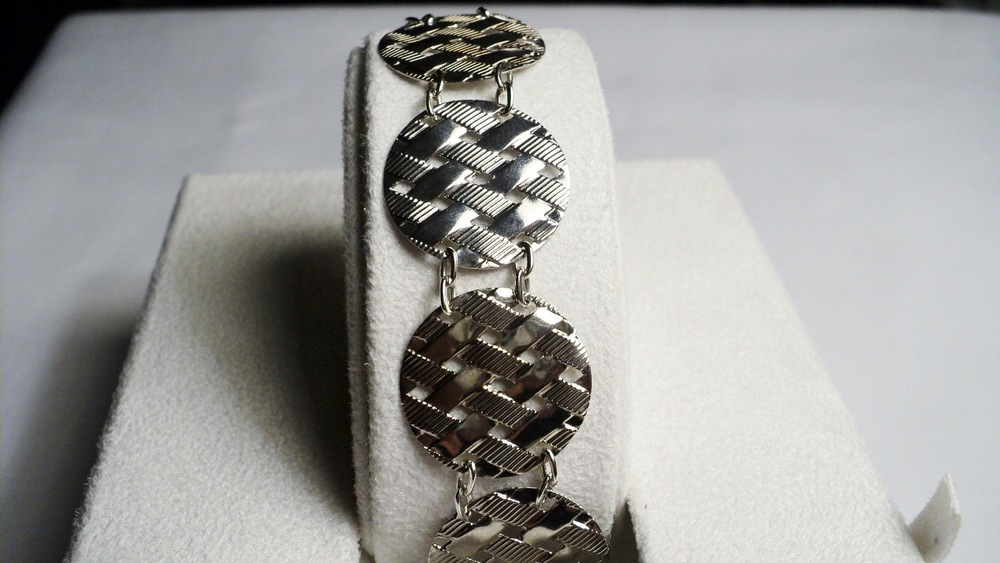 Silver Tone Waffle Disc and Chain Link Bracelet with an Easy Snap Clasp.jpg