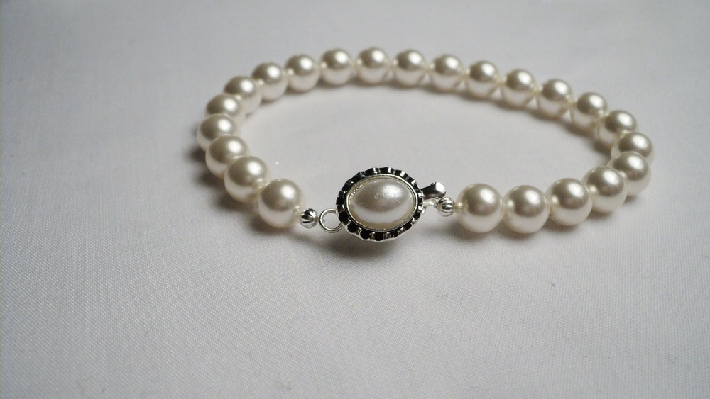 Swarovski Glass Pearl Bracelet with an Oval Glass Pearl Adorned Black Enameled Silver Plated Clasp.jpg