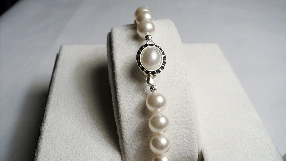 Swarovski Glass Pearl Bracelet with an Oval Glass Pearl Adorned Black Enameled Silver Plated Clasp2.jpg