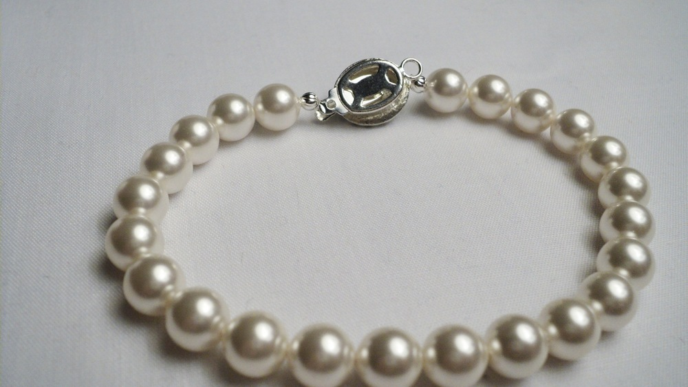 Swarovski Glass Pearl Bracelet with an Oval Glass Pearl Adorned Black Enameled Silver Plated Clasp3.jpg