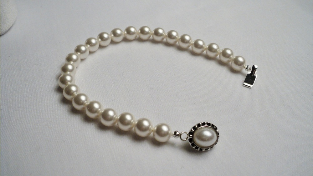 Swarovski Glass Pearl Bracelet with an Oval Glass Pearl Adorned Black Enameled Silver Plated Clasp4.jpg