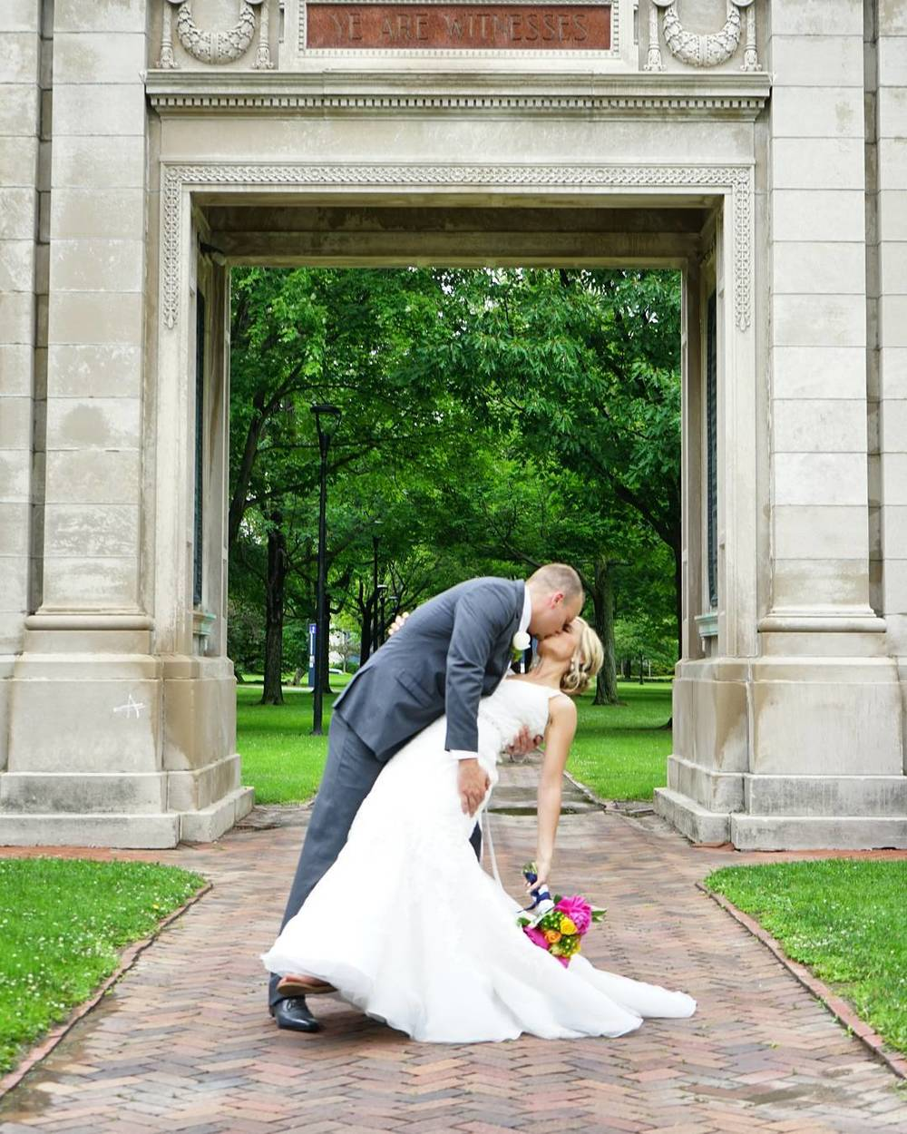 A_walk_through_the_park_turned_into_a_beautiful_wedding_portrait___Shot_with__sonyalpha__Edited_in__on1pics___wedding__weddingphoto__weddingphotographer__tjshots__oberlin__ohio__love__kiss__bride__groom.jpg