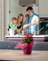 11754077-young-family-cooking-in-a-modern-kitchen-setting.jpg