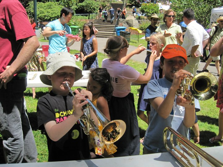 A young duo performs on the Magik Musical Petting Zoo's cornets.
