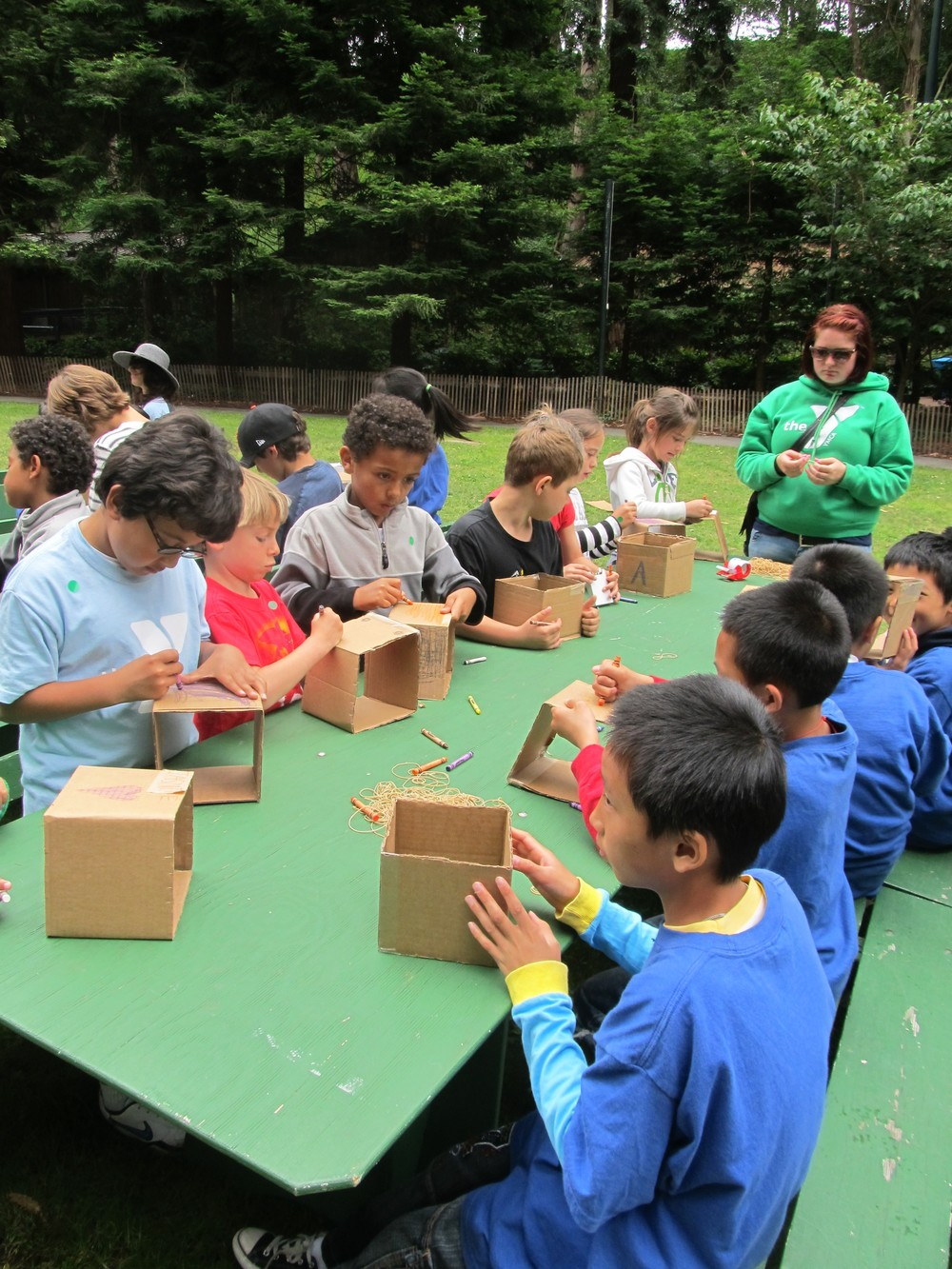 Campers building guitars from cardboard and rubber bands