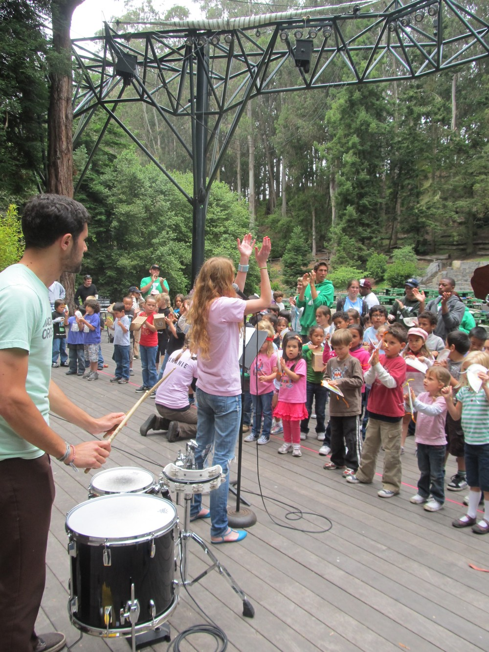 Amy and Andrew lead campers and their brand-new instruments in a song