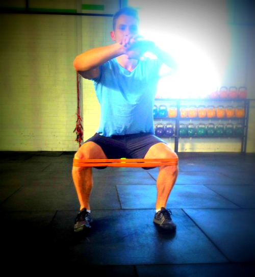 Banded knee squats with some chronic sunlight hitting our camera lens