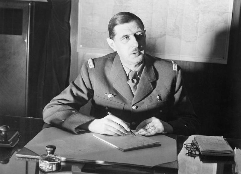 1. Commander_of_Free_French_Forces_General_Charles_de_Gaulle_seated_at_his_desk_in_London_during_the_Second_World_War._D1973.jpg