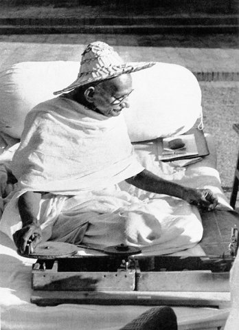 Here Gandhi is wearing a Noakhali hat whilst spinning at Birla House, New Delhi