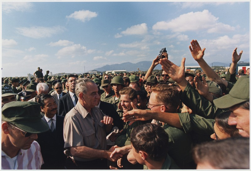 President Lyndon B Johnson greets troops in Vietnam. December 1967.