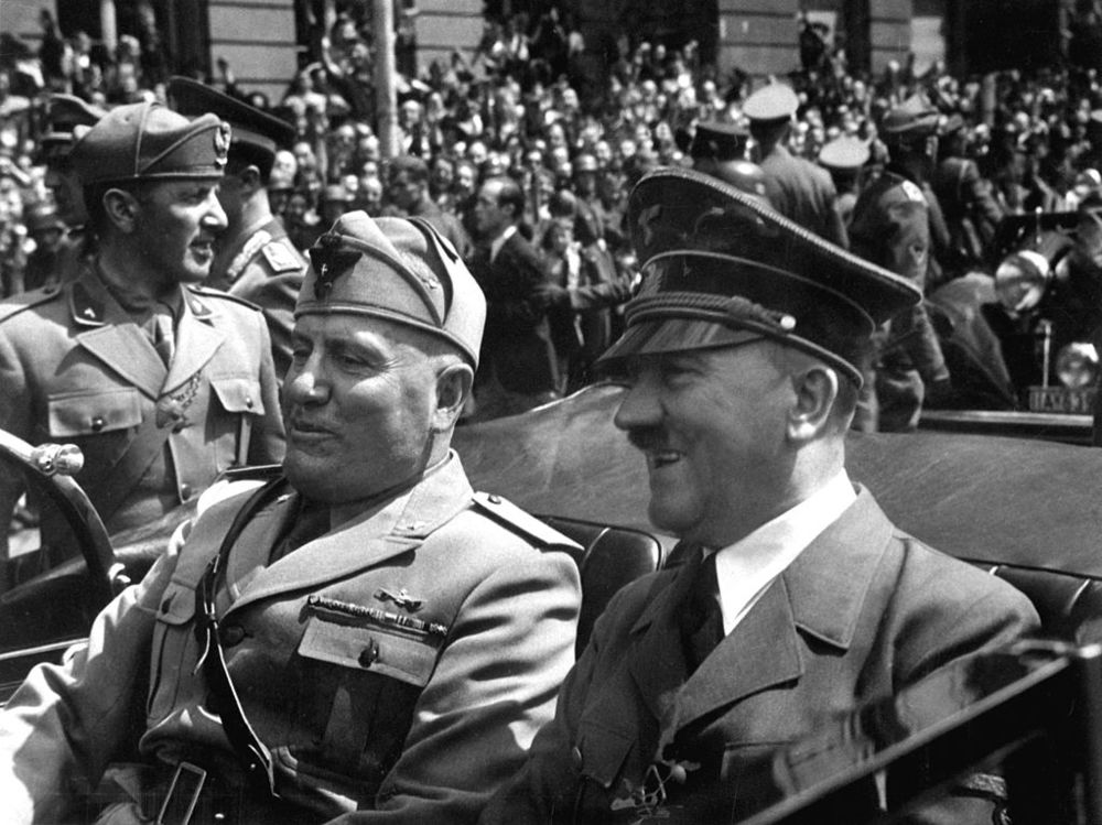 Fascist leaders Benito Mussolini and Adolf Hitler together in Munich in 1940. The pair discussed an invasion of Switzerland during World War Two.